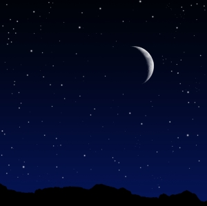 A starry night with a crescent moon.